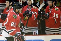 crawford, hossa dominate as chicago ousts wild